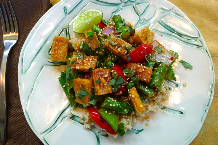 I've been meaning to share this recipe for Sesame-Ginger Baked Tofu since May. As I scan through the photos, I'm amazed at what a difference two months make! We're truly in the dog days of summer n…
