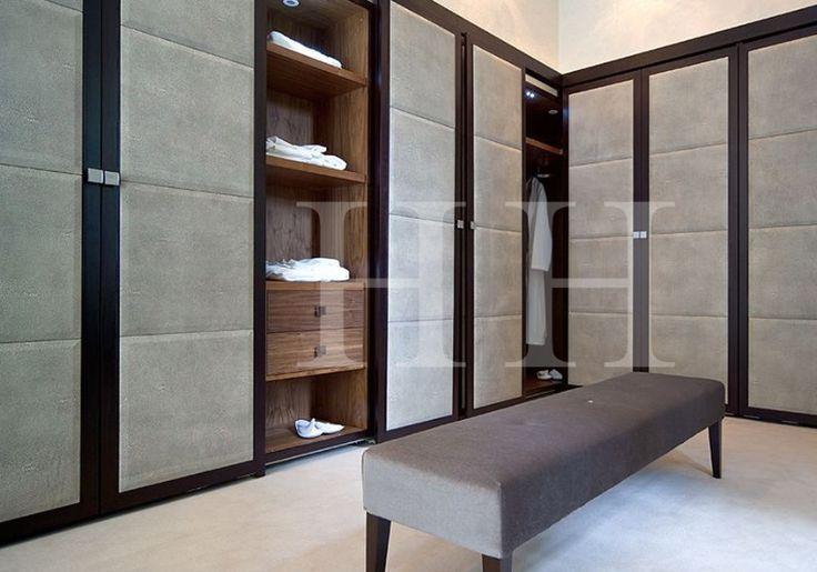 luxury cabinetry dressing room, leather dressing room doors, glass cabinets dressing room #krinteriorblog #luxurydressingroom