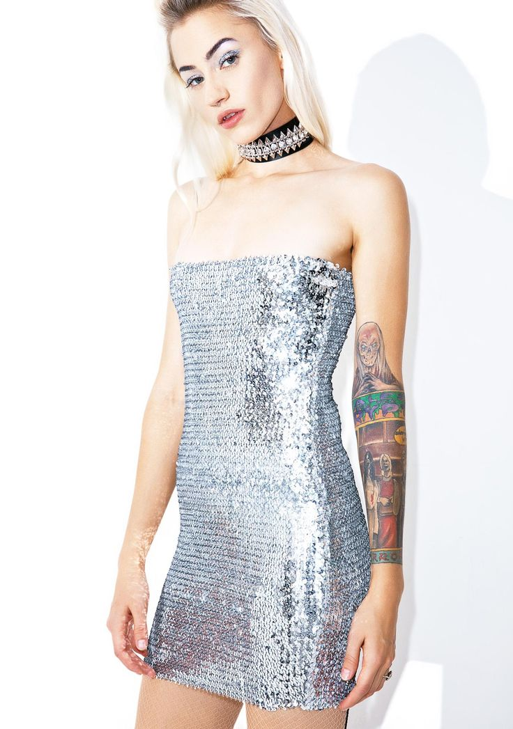Silver Lining Bodycon Dress ...we don't mind payin' the cover if it means we can see you, babe. This ultra hott mini dress features a crazy sparkly silver sequined construction, stretchy curve huggin' fit, tube style, and itty bitty hemline.