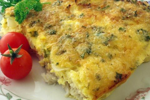 Oven baked fish   1 large onion (chopped)   500 gram firm white fish filets such as South African hake, or New Zealand hoki or warehou   2 to 3 cloves of garlic, chopped   3 eggs   2 table