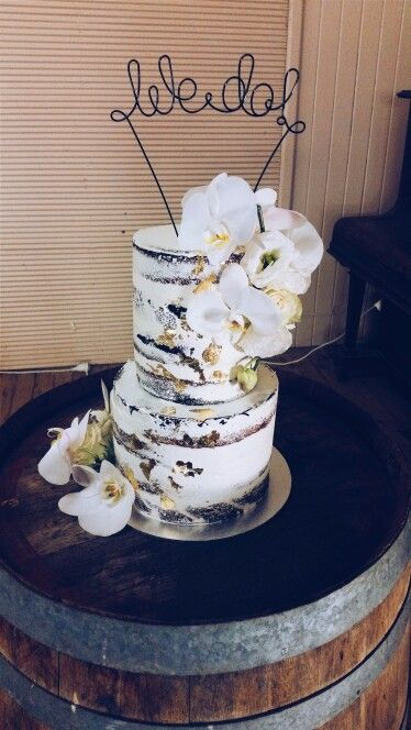 Naked wedding cake with gold leaf detail