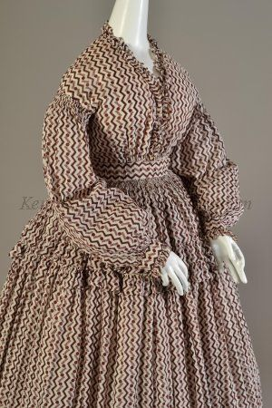 White cotton dress with plum and red zigzag and floral pattern.  American, 1860s  KSUM 1986.127.1