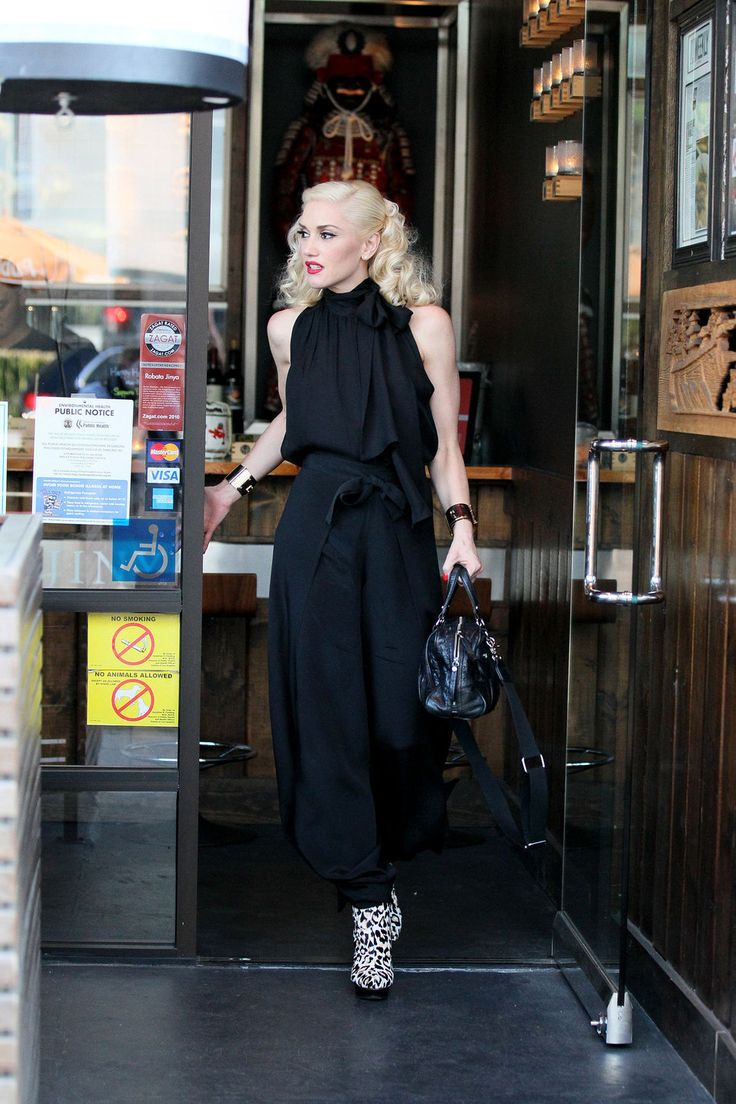 Gwen Stefani black jumpsuit zebra heels red lips
