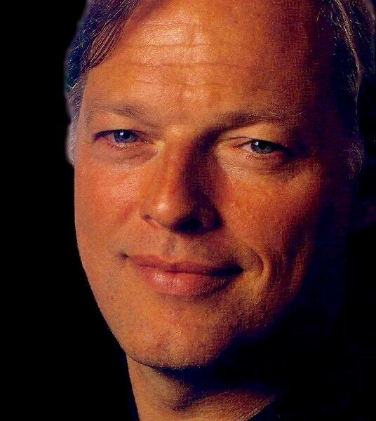 The enormously talented and handsome, David Gilmour, looking content.  What a nice smile.