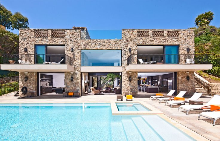 Architecture, Awesome Private House With Stone Wall And Balcony Combined With Pool Featuring Lounge Chairs And Natural View Surroundings: Private House Designs with Splendid and Luxurious Contemporary Themes