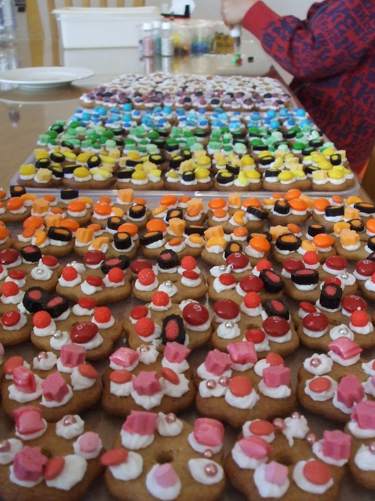 A rainbow of cookies for the school fete. Fete ideas