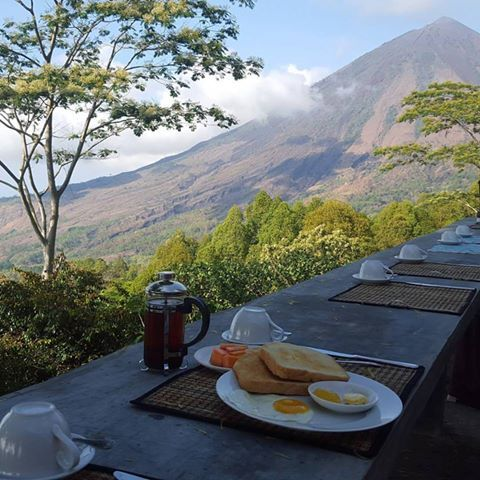 #FloresIndonesia THIS is what we call: Breakfast with a view. Overlooking Mt Inerie, this cozy countryside lodge is one amazing hidden gem!