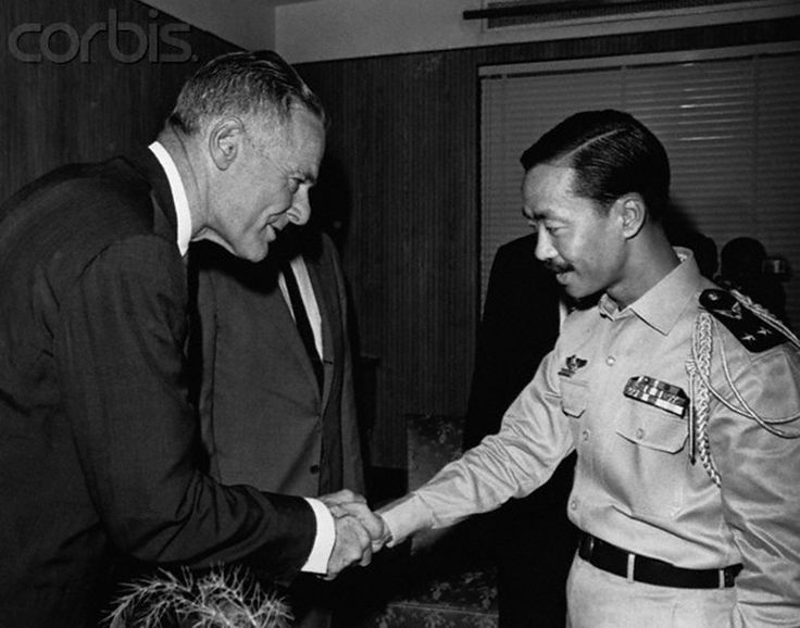 Henry Cabot Lodge (left), U.S. Ambassador to South Vietnam, greets Vietnamese Prime Minister, Air Vice Marshall Nguyen Cao Ky. Lodge was on a fact finding trip for President Johnson in July 1965