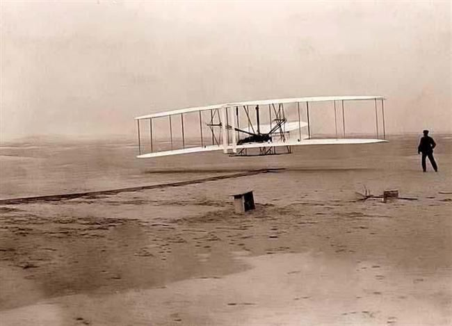 "First Flight - The world changed at 10:35 AM, on December 17, 1903 on the north side of Kill Devil Hills, Kitty Hawk, North Carolina. It was at that moment that the Wright Brother's ""Wright Flyer"", with Orville Wright at the controls, lifted off in sustained, controlled flight."