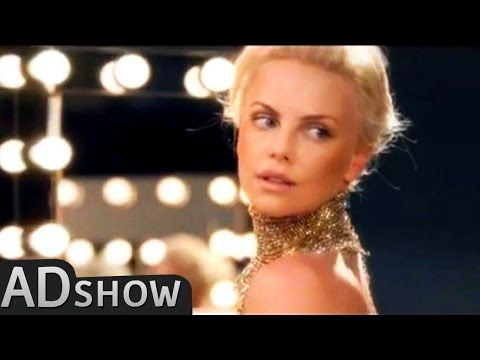 """Charlize Theron in J'adore Dior commercial. Music + some lyrics of the song """"Perfect World"""" -- or """"Heavy Cross"""" (???) -- by Gossip accompanies the ad."""