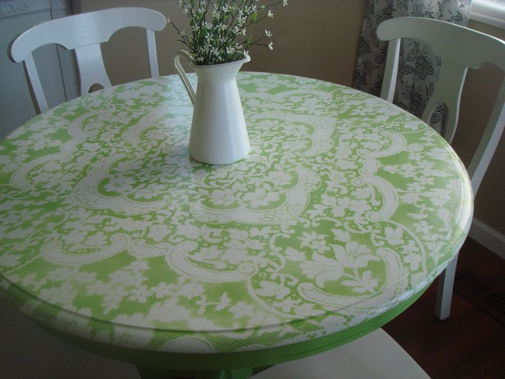 spray paint thru lace. green painted table