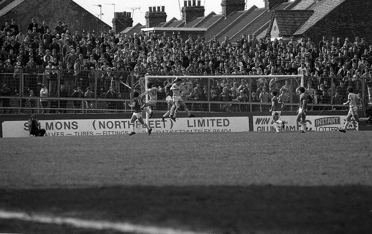 Big old away terrace at Priestfield, Gillingham FC, sadly now replaced with meccano temporary seating. Stuck in the arse end of Kent the ground's surrounded by run-down housing and the home fans have nicked Millwall's 'No-one likes us' song...
