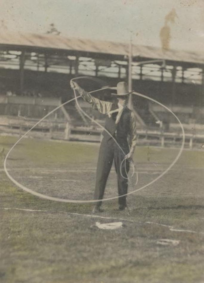 Digital Photograph - Holden Brothers Circus, Man in 'Cowboy' hat spinning a lasso in Showground, Royal Melbourne Show Ground, Ascot Vale, circa 1910