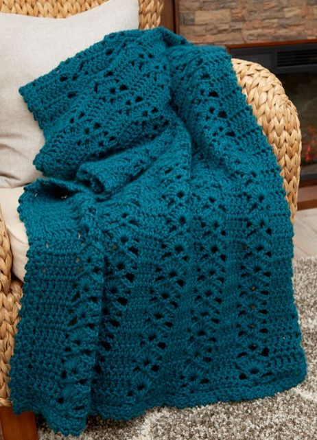 The Falling Leaves Afghan Pattern is just what you need to cozy up on a chilly fall evening. The easy crochet blanket's design looks like autumn leaves.