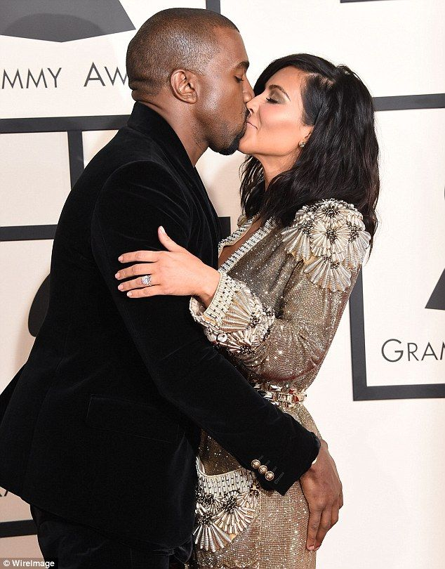 Golden girl: Kanye couldn't keep his hands off his stunning wife's world-famous bottom as they enjoyed their high-profile date night on the Grammys red carpet