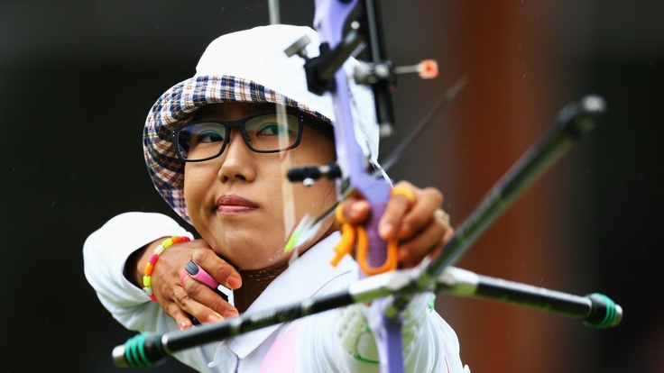 Lee Sung Jin of Korea competes in her women's Individual Archery 1/16 eliminations match against Kristine Esebua of Georgia during Day 4 of the London 2012 Olympic Games at Lord's Cricket Ground