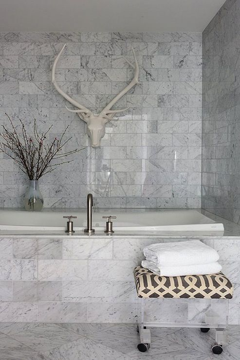 Carrara Marble Bathroom With Lucite Stool Upholstered In Kelly Wearstleru0027s  Imperial Trellis In Charcoal.