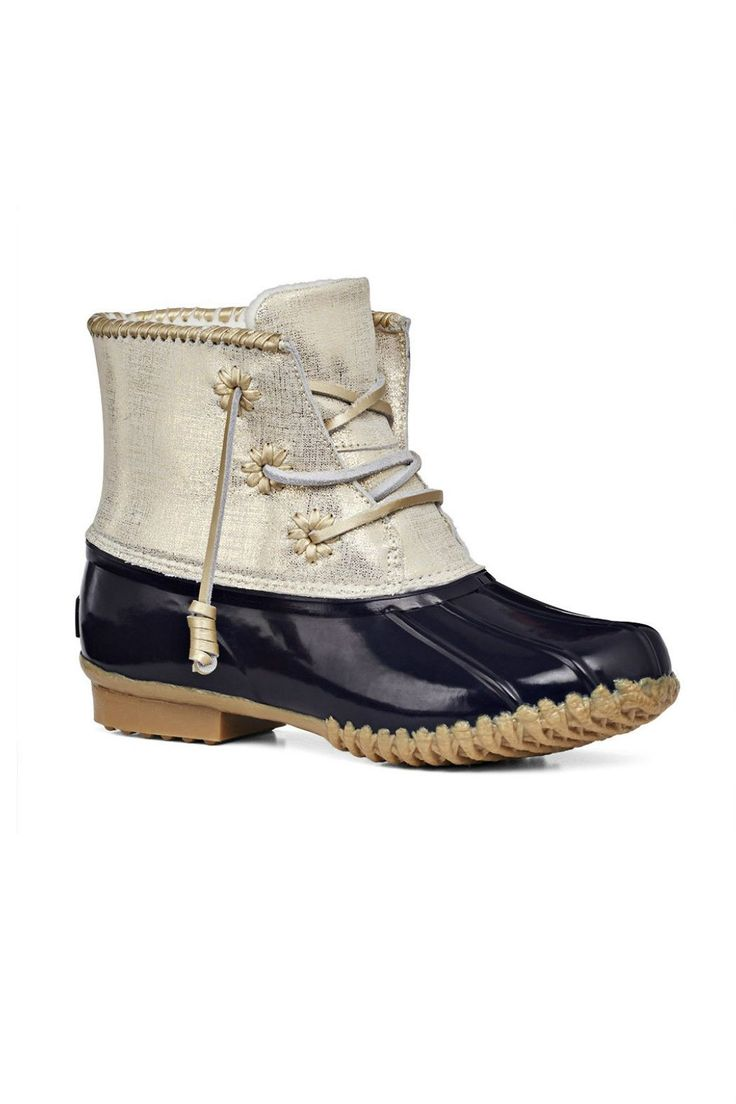 Chic cold-weather boots do exist! This durable, all-weather boot features a navy…
