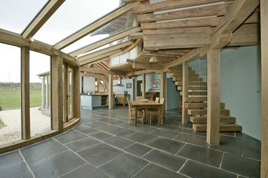 Curved green oak framed conservatory by Roderick James Architects