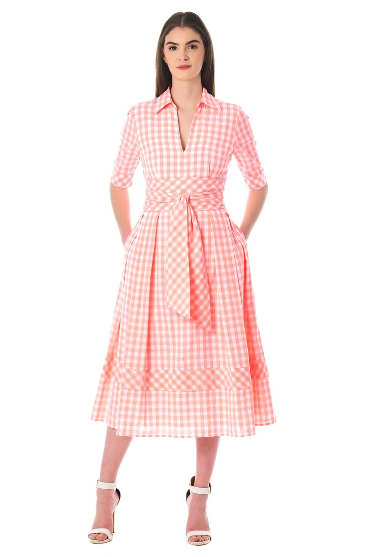 Our gingham check cotton dress is cinched with a wide obi style sash tie belt and flared with inverted pleats and banded hem at the full skirt.