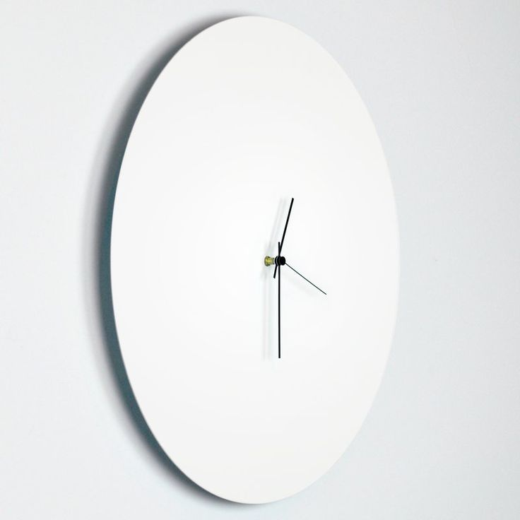 A minimalist twist on the traditional wall clock. Resolve to find contentment with the time you are given, without obsessing over the numbers. Feel things you have never felt before. Experience different points of view. Make the best of it. Live a life you are proud of. Discover the value of time with The Adam Schwoeppe Minimalist Circle Clock, an elegant eclectic timepiece. Revitalize your home decor as time passes silently with this modern white circle clock.