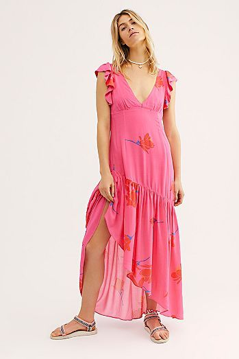 10437d031e She's A Waterfall Maxi Dress, presented by Free People. Also in lemon.  Floral printed maxi dress featuring a femme flutter sleeve.