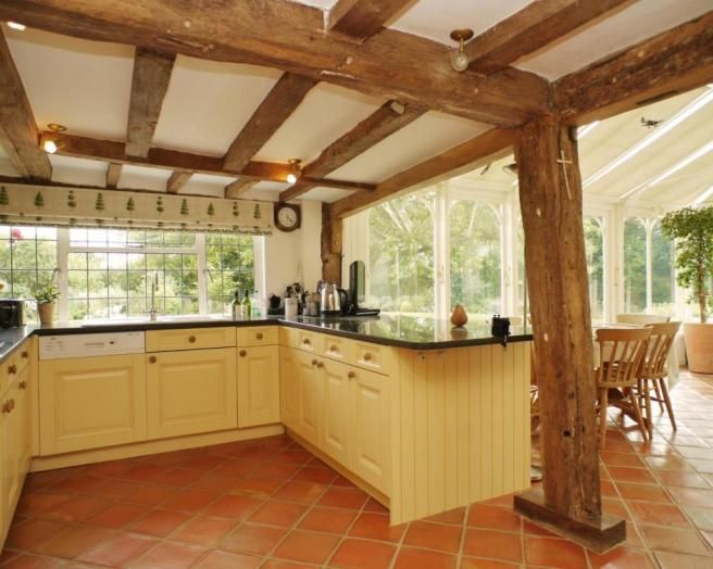 Photo Of Country House Country Kitchen Exposed Wood Beams Light And Airy Shaker Beige Brown Cream Kitchen Flooringkitchen Tilestile