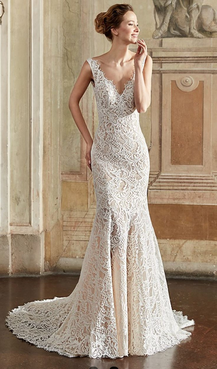 Eddy K collection Style EK 1084    Lace fit'n'flare gown. V-neck and cap sleeves.  Available in: ivory/skin, champagne/skin