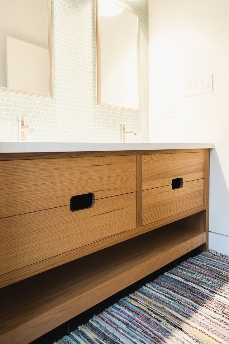 Beautiful warm wood floating vanity with drawer cutouts.  Modern and wonderful.
