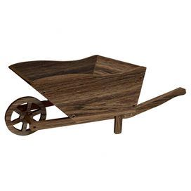 """Distressed wood wheelbarrow decor.   Product: Wheelbarrow decorConstruction Material: WoodColor: NaturalFeatures: Wheels and handles for easy mobilityDimensions: 11"""" H x 14"""" W x 9"""" D Note: For decorative use only"""