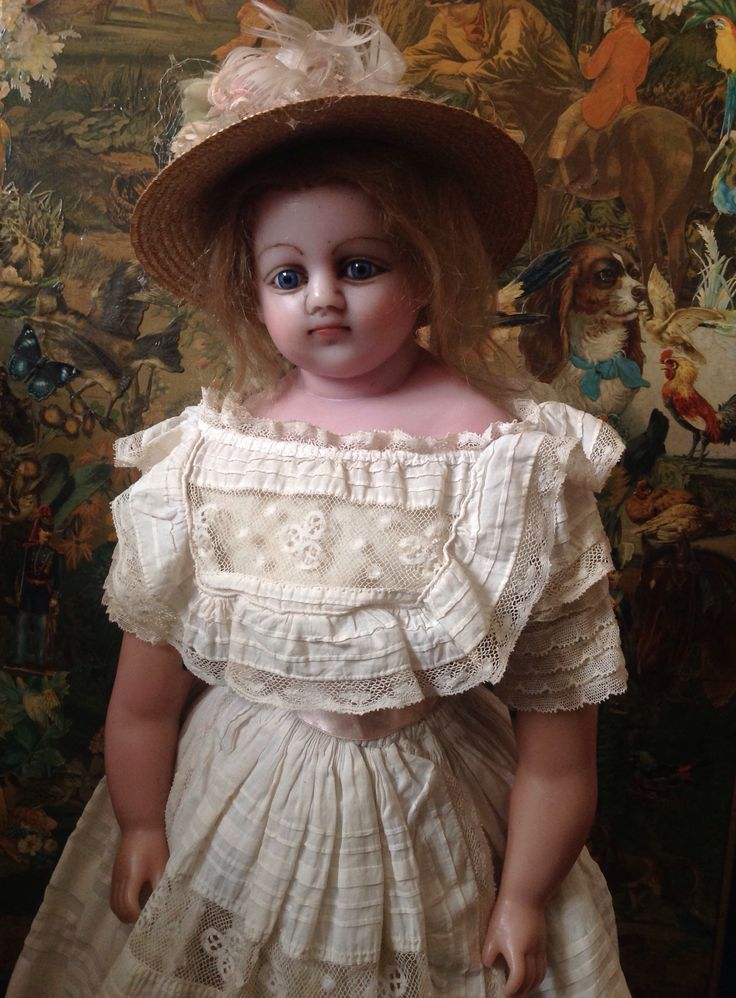 Victorian poured wax girl doll of 22 inches, with original wooden box.