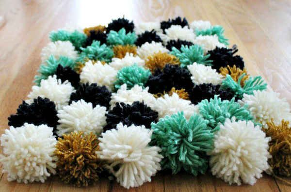 10 Perfectly Cozy DIY Projects. Pom Pom Blanket - Make it for: those mornings when you're dreading letting your feet touch the cold, cold apartment floor.: