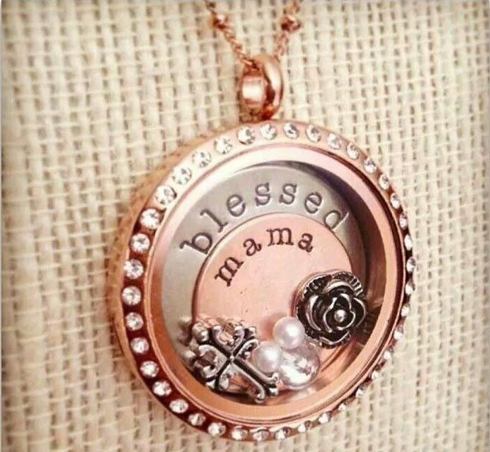 Any mother would be proud to wear this beautiful rose gold locket. Large rose gold locket with crystals, large silver blessed plate, medium rose gold mama plate, vintage rose charm, vintage cross charm and pearls. Elegant! Please visit my facebook page - Heidi Von Rehder - Origami Owl Independent Designer #35225. I am in Eastvale, CA, 92880.