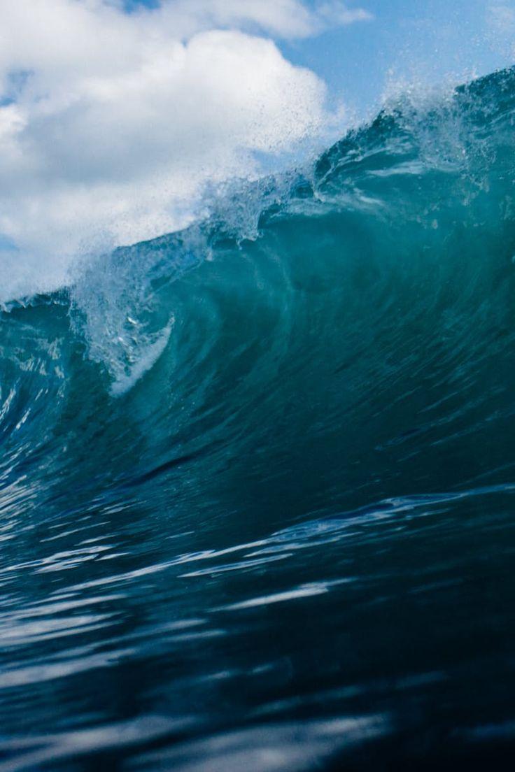 Rolling Ocean Waves Under Clear Blue Sky
