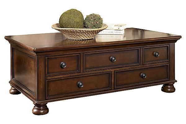 """The Porter Coffee Table with Storage from Ashley Furniture HomeStore (AFHS.com). With a rich rustic beauty radiating from the stylish details, the """"Porter"""" accent table collection flawlessly transforms the atmosphere of any living room environment."""