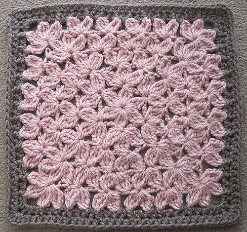 Crocheted in the round like a granny square, it does remind you of a field of flowers. Thinking of this for a throw or pillow.
