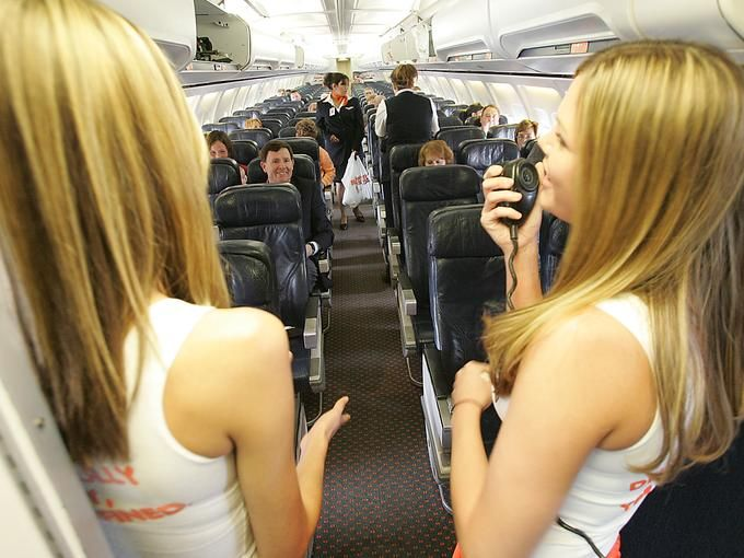 Jessica Goldammer and Erica Dircks  greet passengers on Hooters Airlines' first flight to Pittsburgh from Myrtle Beach International Airport, Feb. 25, 2005.
