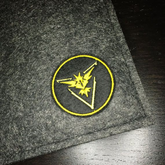 What better way to show pride for your team than to have a Team Instinct patch! This premium patch embroidered with vivid colours on a durable felt base. It measures approximately 2.0 x 2.0  This patch can be sewn or ironed on to your favorite knapsacks, jeans or jackets. For removable options, choose our pin backed version that has a bar pin fastened to the back.