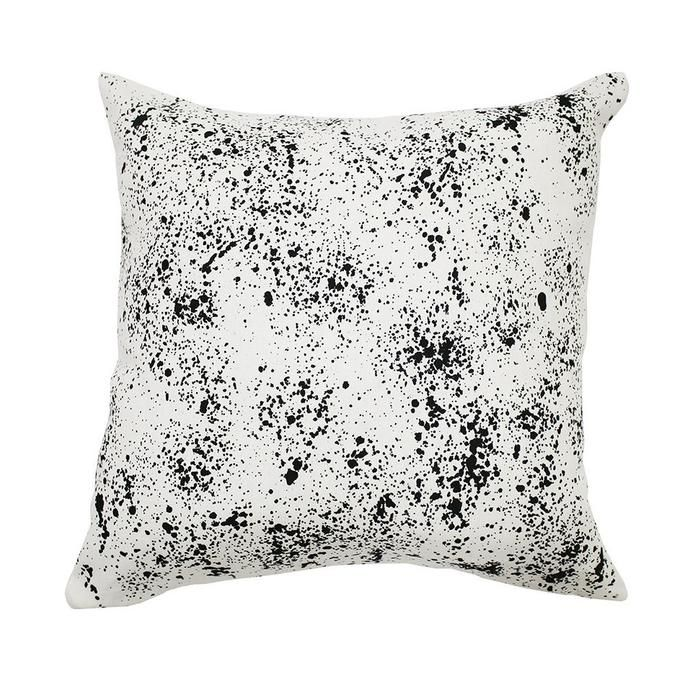 off-white linen cushion cover with black splashes