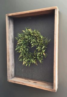 """Our smilax wreath will bring natural warmth to your home.  Pairs well with our Garden Sifter or mounted on a vintage window pane.  Dimensions - 7"""" opening, 12"""" diameter"""