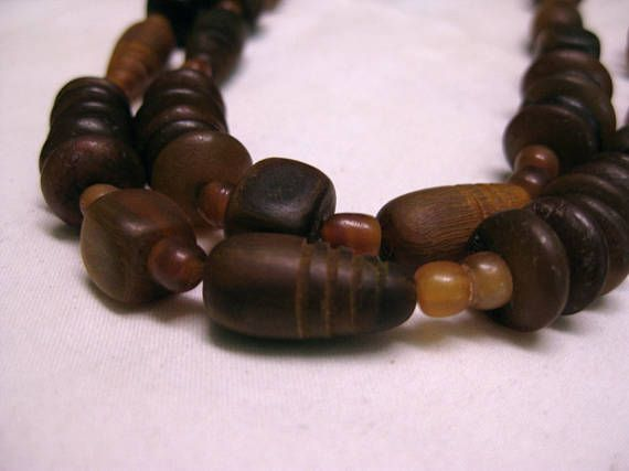 carved wood and amber beads on a continuous strand. this is a heavy and sturdy piece,