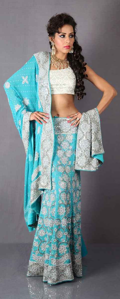 Water blue lehenga choli...this looks a bit like the dress i wore to my cousin's wedding!!!! IT'S BEAUTIFUL