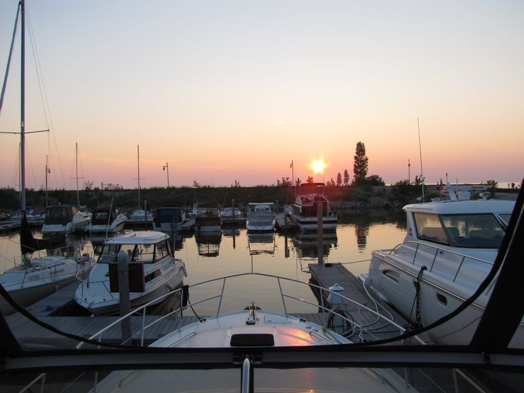 This sunset comes from our stay at Kincardine Marina on Lake Huron. They claim the world's best sunsets - you tell me. — at Kincardine Yacht Club (Light House). . . +++ Join the husband and wife cruising & traveling couple - the 'Boogaboo Crew' - as we set sail to fun & adventure! Watch Hundreds of original #boating & #travel videos, join us on Facebook, read our Blog and much more, all at http://Boogabooster.com