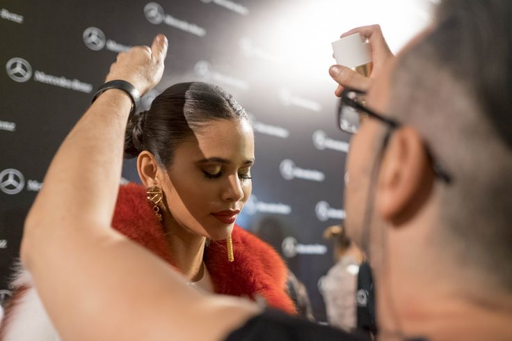 Last touch before the show. Backstage at Varela Crystal Army Fashion Show.