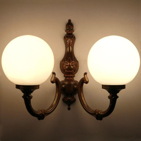 Create an ornate focal point on your wall with Ben 2 Arm Traditional Wall Light for a traditional wall lighting.