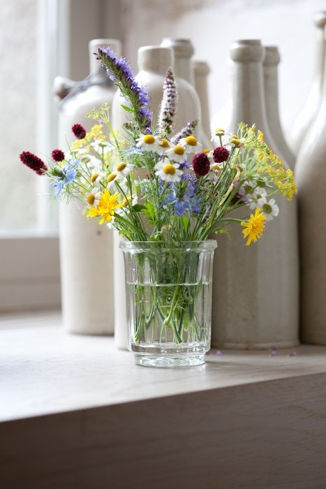 love the arrangement of these wild flowers, usually as companions to larger blooms, but now standing proudly against one another in a simple clear vase...