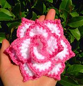 For this Rose the only reason you will need to use a needle is to weave in your ends. There is no wrapping or rolling with this pattern. You can make it one solid color, or use up to 3 different colors. Add it to a stem to put into a vase, or attach to an ear warmer or shawl for a pop of decoration.