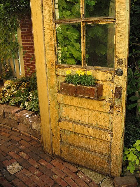 Old Chippy Mustard Door...with a wooden flower box...love the color!