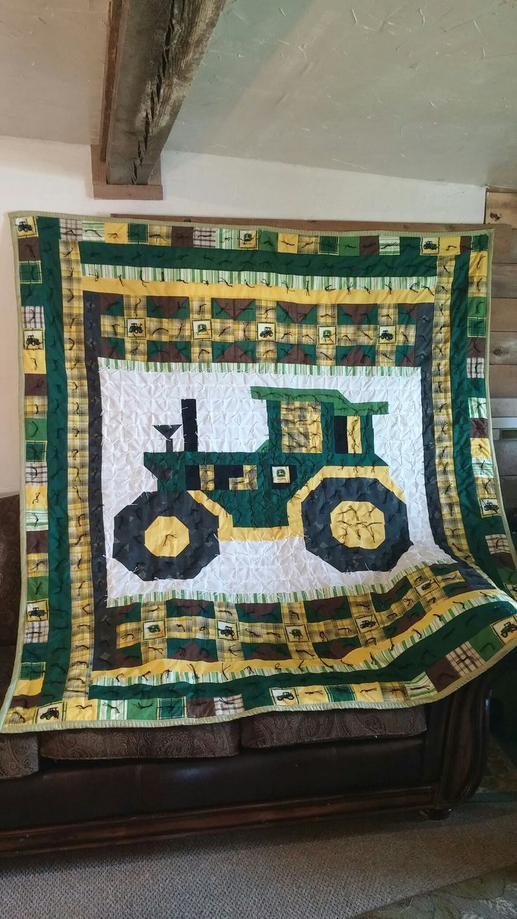 John Deere Tractor Quilt... I found a 1/2 yard of John Deere fabric at a second hand store and just knew I needed to design a quilt out of it!  Thanks to the person who had already done a grid outline of a tractor on Pinterest.  (over 400 squares in that center section alone).  Then I built the rest of the quilt around the tractor.  I am giving it to my son who is graduating from a community college next week with his AG degree.  (shhhhh... it's a surprise)
