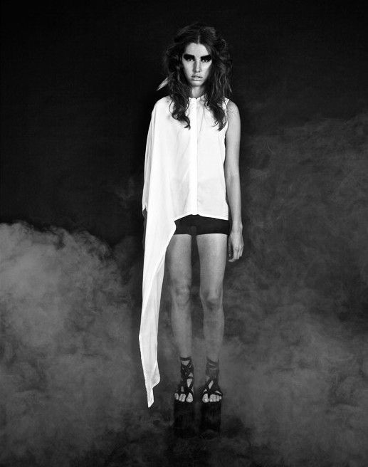 """Asymmetric White Blouse from """"Tribal Future"""", the 2012 collection by swiss/swedish designer SARA BURKHARD."""